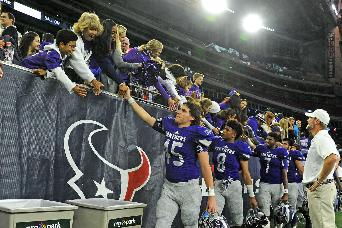 Ridge Point's Matt DeLeon (45), Jarrett Preston (8) and Shane Gosson (7) celebrate with fans after their Class 5A Division II regional semifinal victory against A&M Consolidated, Nov. 28 at NRG Stadium in Houston. To view or purchase this photo and others like it, visit HCNpics.com.