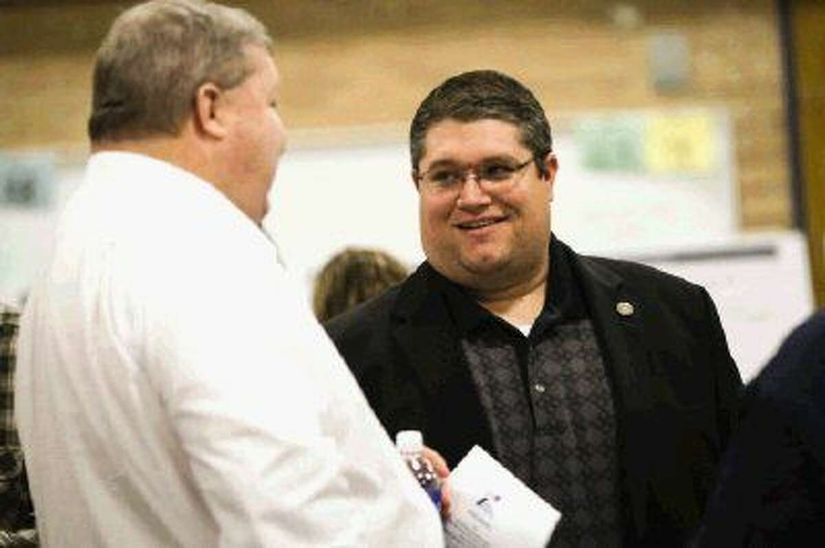 Montgomery County Pct. 4 Commissioner Jim Clark, left, chats with Jason Millsaps, Chief of Staff for State Rep. Mark Keough, during the TxDOT open house about plans for widening SH 105 on Tuesday, Dec. 1, at Austin Elementary in Conroe.