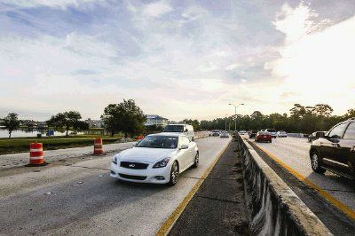 Morning commuters drive in narrow lanes Nov. 3 due to stalled construction on Woodlands Parkway.