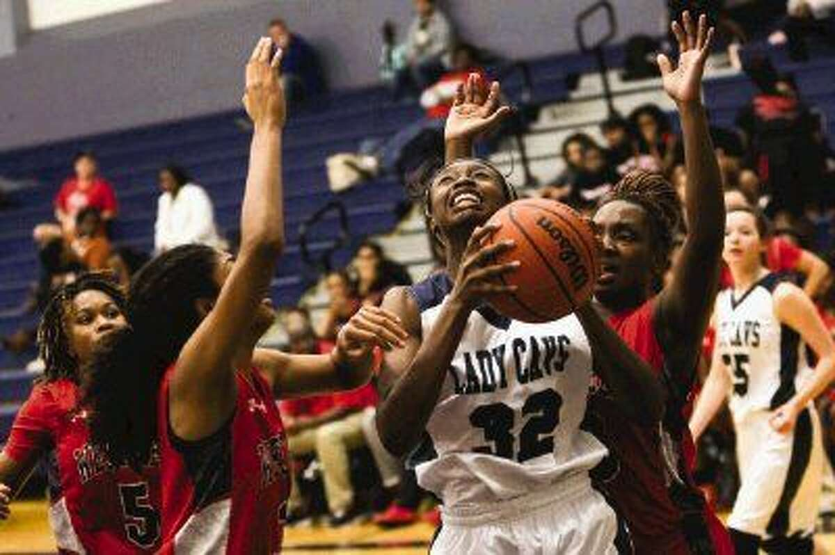 College Park's Jasmine Atobajeun (32) tries to get past Westfield defenders during the high school girls basketball game on Tuesday, Dec. 9, 2014, at College Park High School.