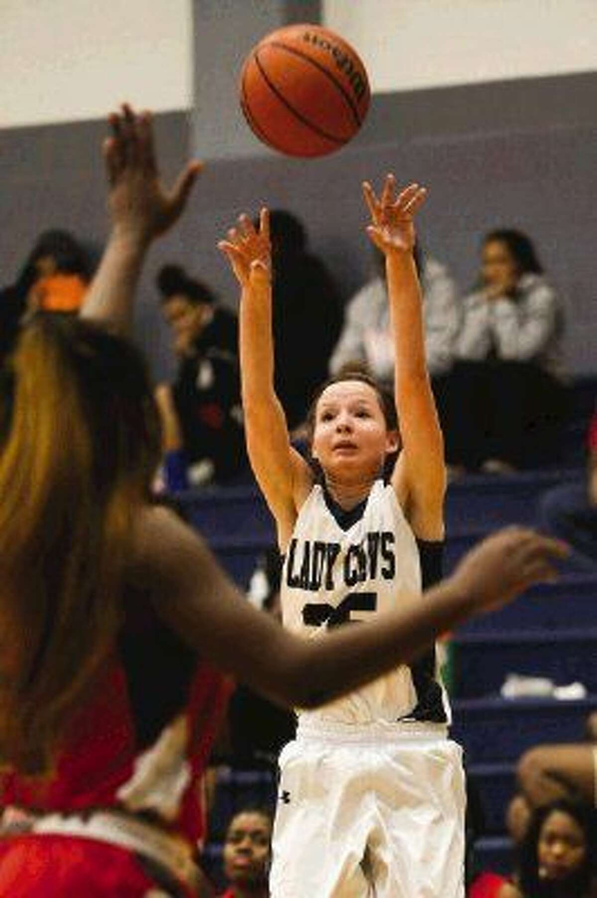 College Park's Haley Fitzpatrick (25) shoots for the basket during the high school girls basketball game against Westfield on Tuesday, Dec. 9, 2014, at College Park High School.