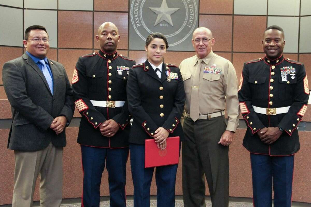 Pasadena High School Principal Joe Saavedra; Marine Instructor Gy. Sgt. Bryan Hamm; Cadet Jasmin Astorga; Regional ROTC Director Lt. Col. Mark Stroman and Senior Marine Instructor Master Sgt. Shafi McCants.