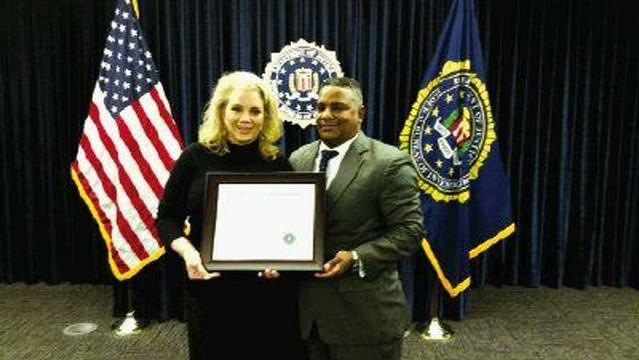 Special Agent in Charge of the Houston Field Office of the Federal Bureau of Investigation Perrye K. Turner announced the 2015 FBI Director's Community Leadership Award will be presented to K9s4COPs, a Houston based nonprofit organization. Turner presented the certificate announcement to K9s4COPs founder and chairman, Kristi Schiller.