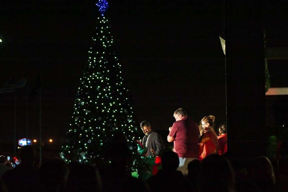 deer park mayor jerry mouton pushes the button to light the christmas tree standing on the