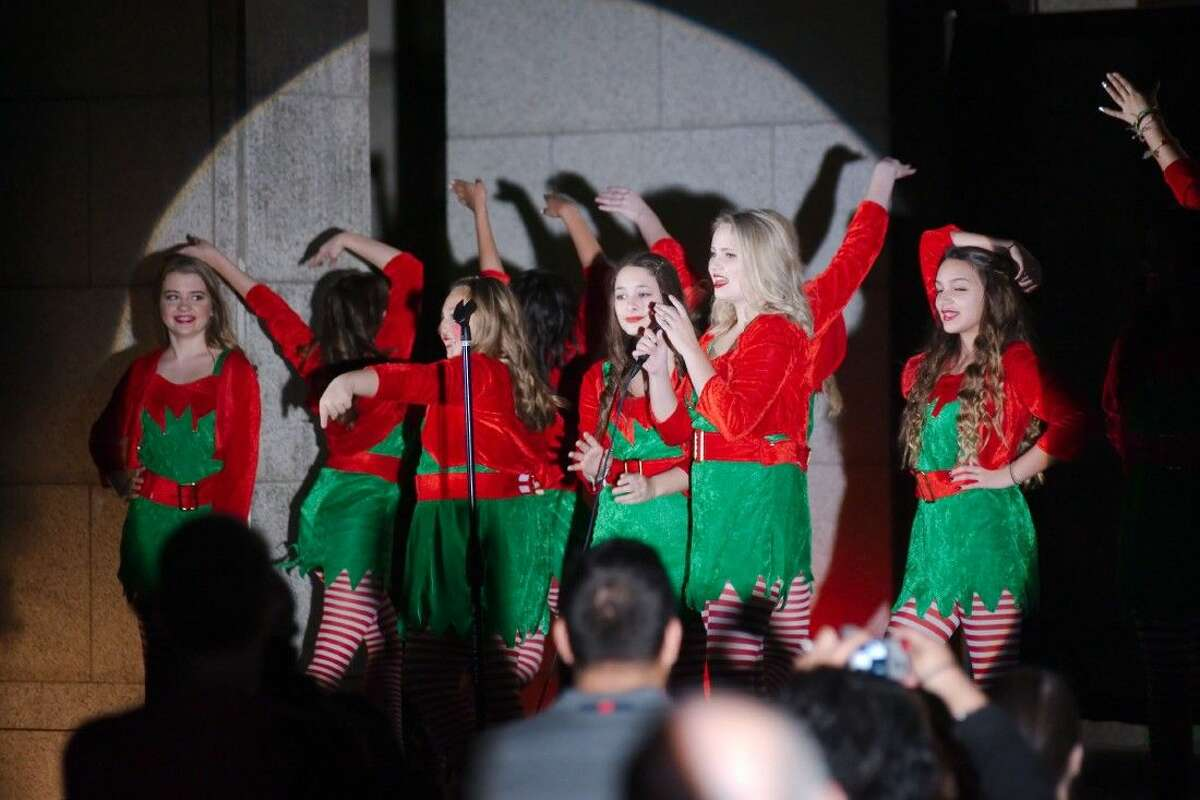 The Art Park Players REACTION perform during the City of Deer Park Annual Tree Lighting ceremony Friday, Dec. 5.