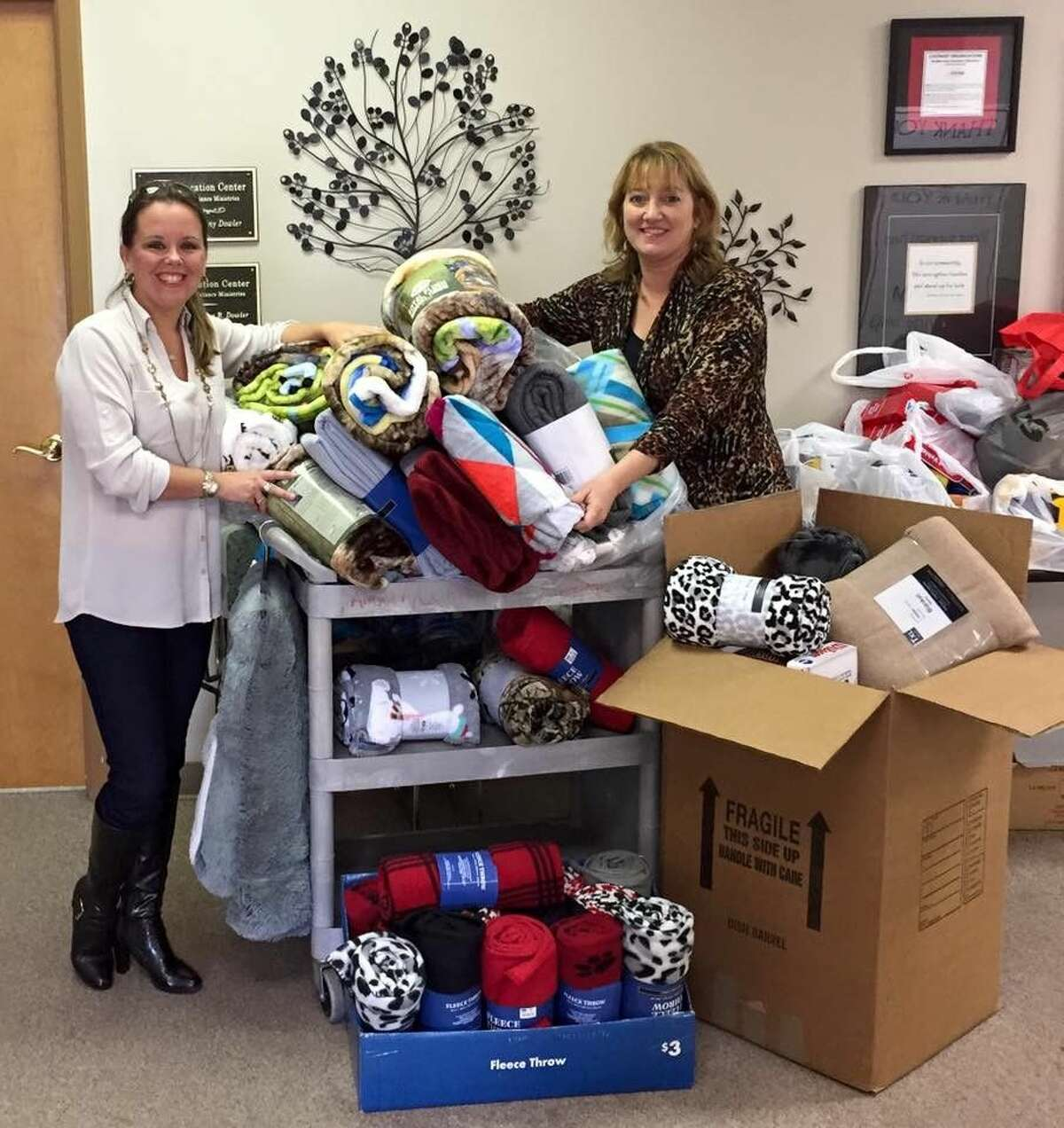 """Page Cherry, left, with Millie Garrison, executive director at HAAM, when """"Page's Blanket Drive"""" dropped off blanket donations at the nonprofit's offices in Humble."""