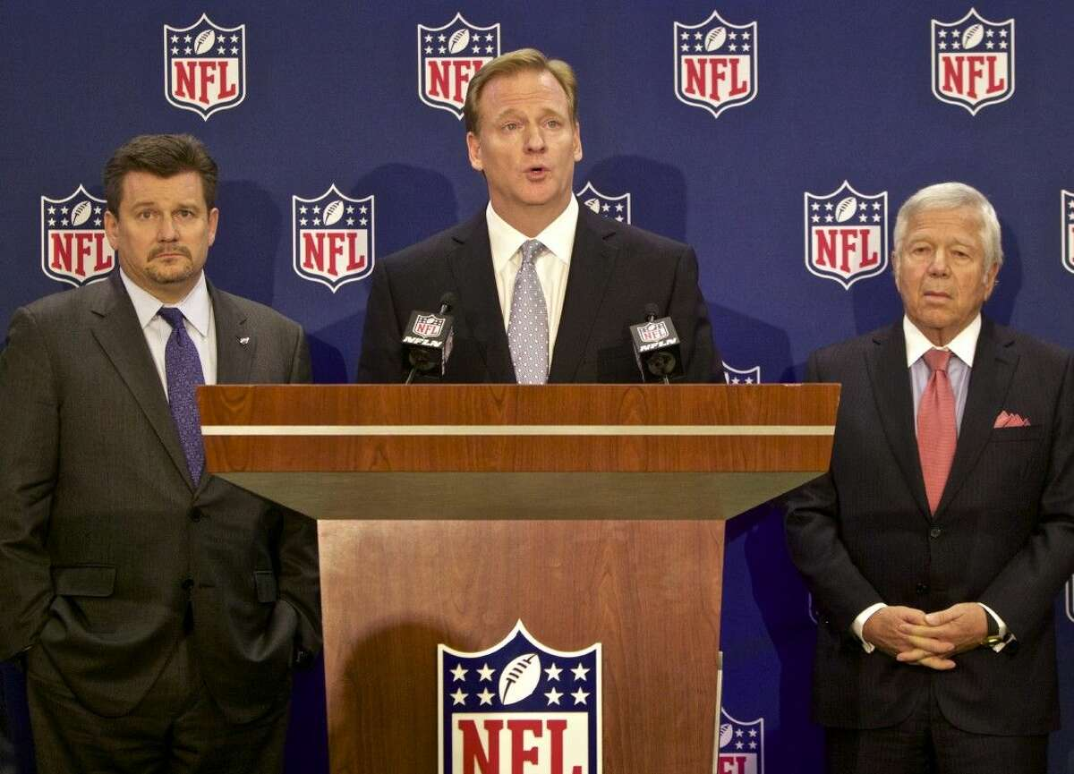 NFL commissioner Roger Goodell, center, speaks at a press conference announcing new measures for the league's personal conduct policy during an owners meeting on Wednesday.