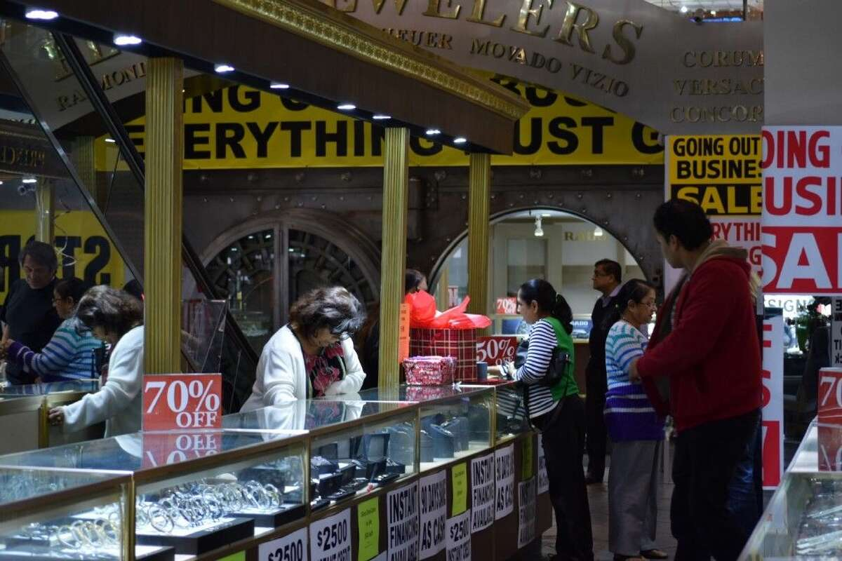 Shoppers at the Jewelry Exchange in Sharpstown eye liquidation deals. The store is closing on Dec. 31 after 24 years in business.