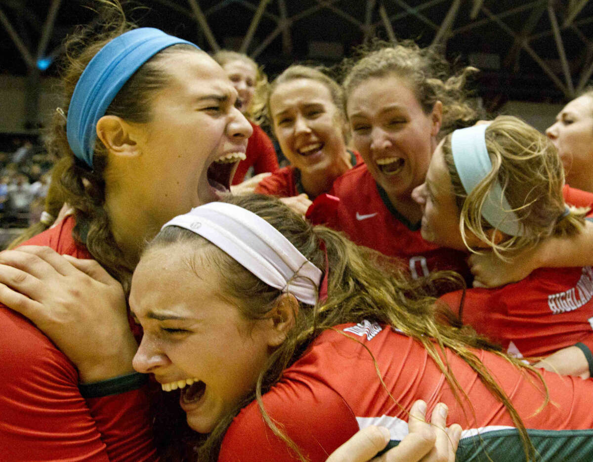 The Woodlands celebrates after defeating Clear Falls 3-1 to win their second straight state title at the UIL State Volleyball Championships in Garland Saturday. To view or purchase this photo and others like it, visit HCNpics.com.