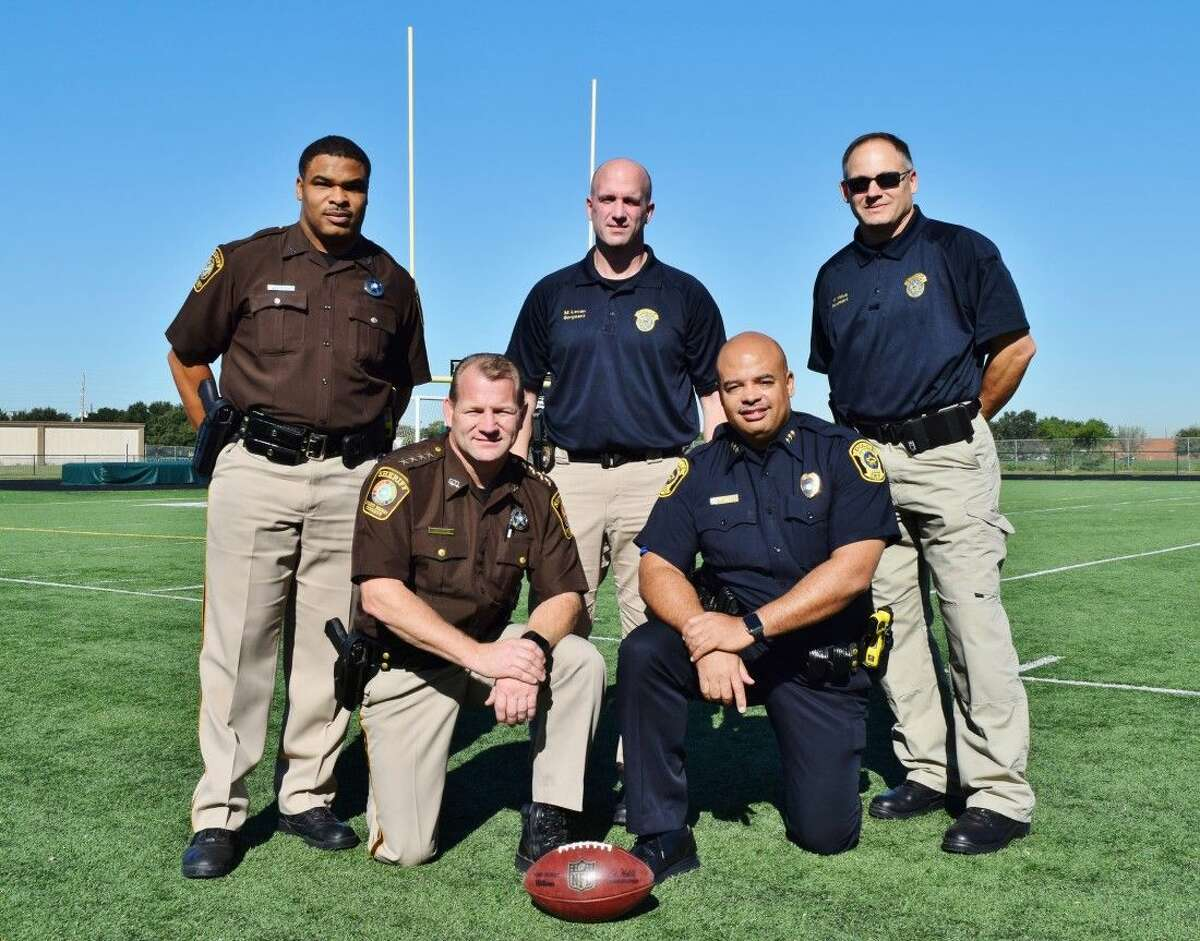 Ready for the Holiday Bowl's Battle of the Bend are (front row, from left), Fort Bend County Sheriff Troy E. Nehls and Sugar Land Police Department Chief Doug Brinkley; (second row, from left), Sheriff's Office Deputy Frank Davis and Sugar Land Police Department Officers Matt Levan and Marty Maus.