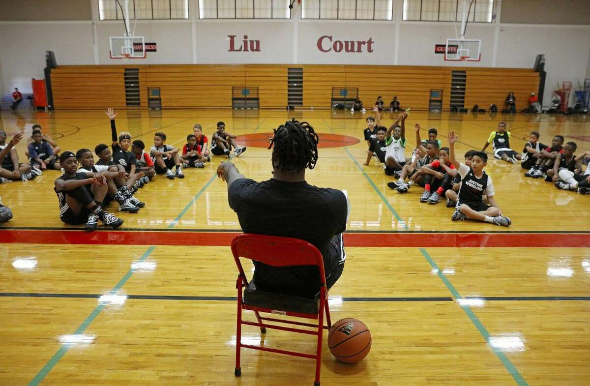 Miami Heat forward Justise Winslow hosts kids during a basketball camp at the St. Johns School on Saturday June 25, 2016 in Houston, Texas.