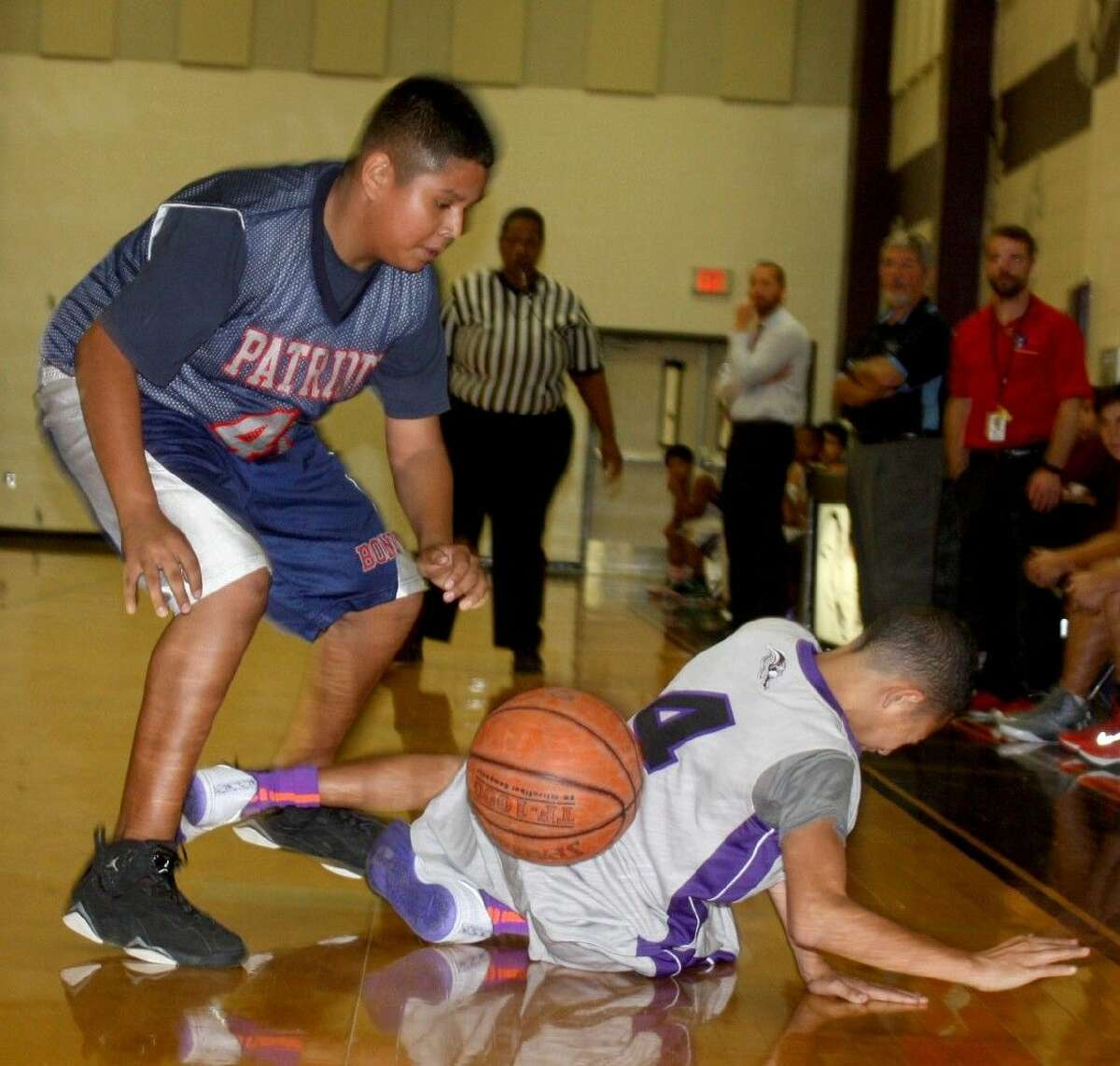 Bondy's Michael Martinez takes advantage of Donovan Berotte on the floor by grabbing the ball in second-half action Wednesday night.