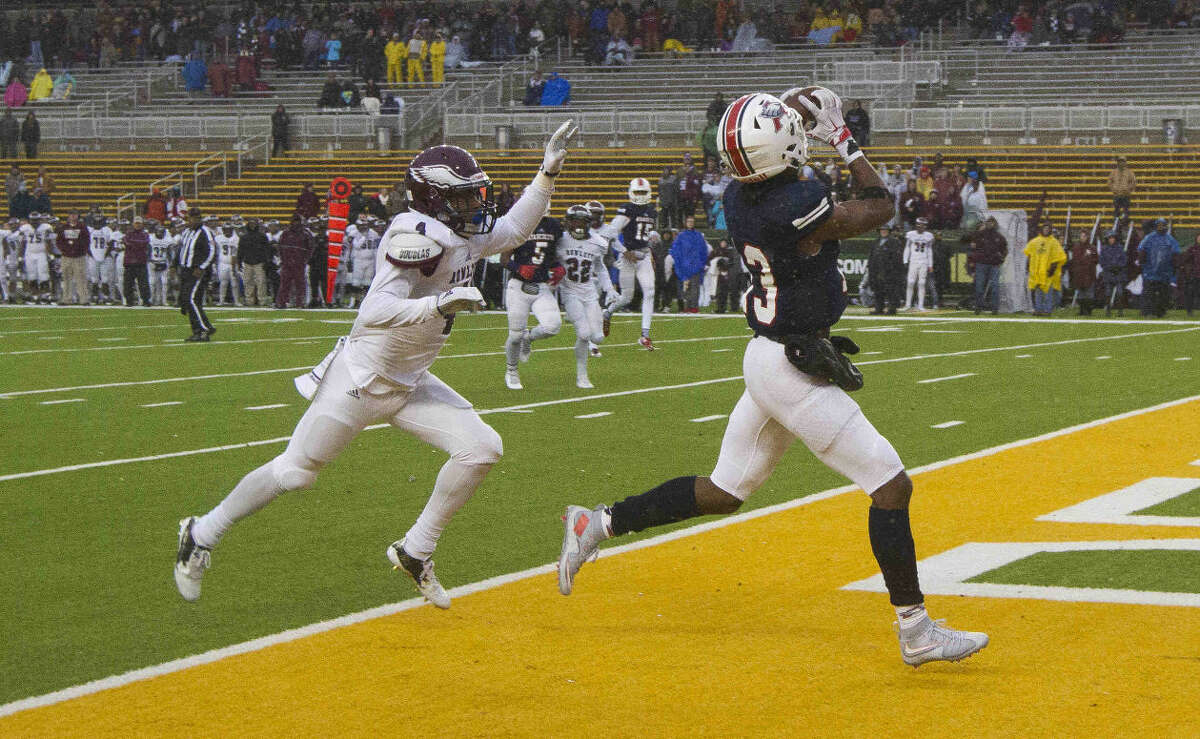 Atascocita wide receiver Coye Fairman catches a 21-yard touchdown pass in overtime of a Class 6A-DI Region II regional playoff game Saturday, Nov. 28, 2015, in Waco. Go to HCNpics.com to view more photos from the game.