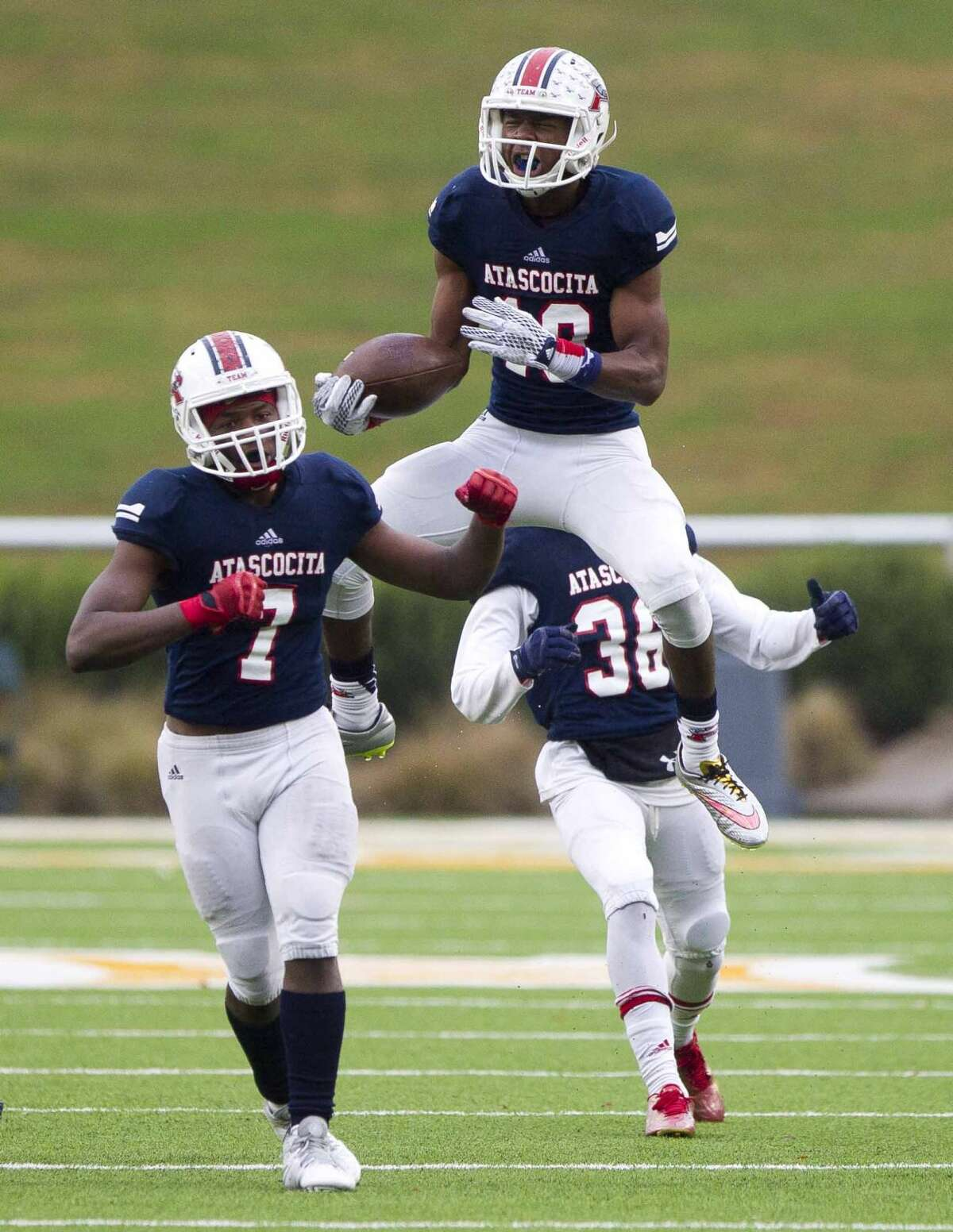 Atascocita defensive back Justen Campbell celebrates after intercepting a pass by Rowlett quarterback Logan Bonner during the third quarter of a Class 6A-DI Region II regional playoff game Saturday, Nov. 28, 2015, in Waco. Go to HCNpics.com to view more photos from the game.