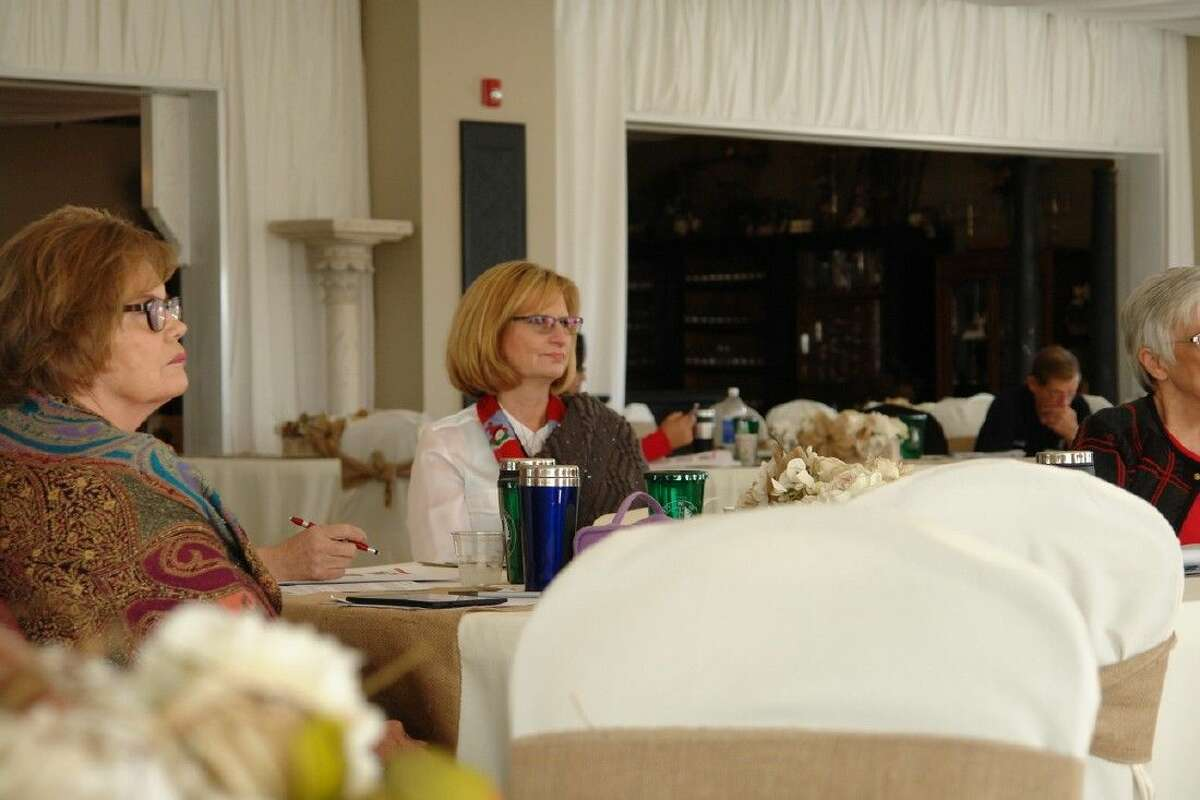 Sandra McQuiggin, Coldspring Chamber of Commerce of San Jacinto County treasurer, listens during a presentation at the Central East Texas Alliance Focus Series at the Shepard Hill Estates in Willis on Wednesday. The series focused on business attraction and retention.