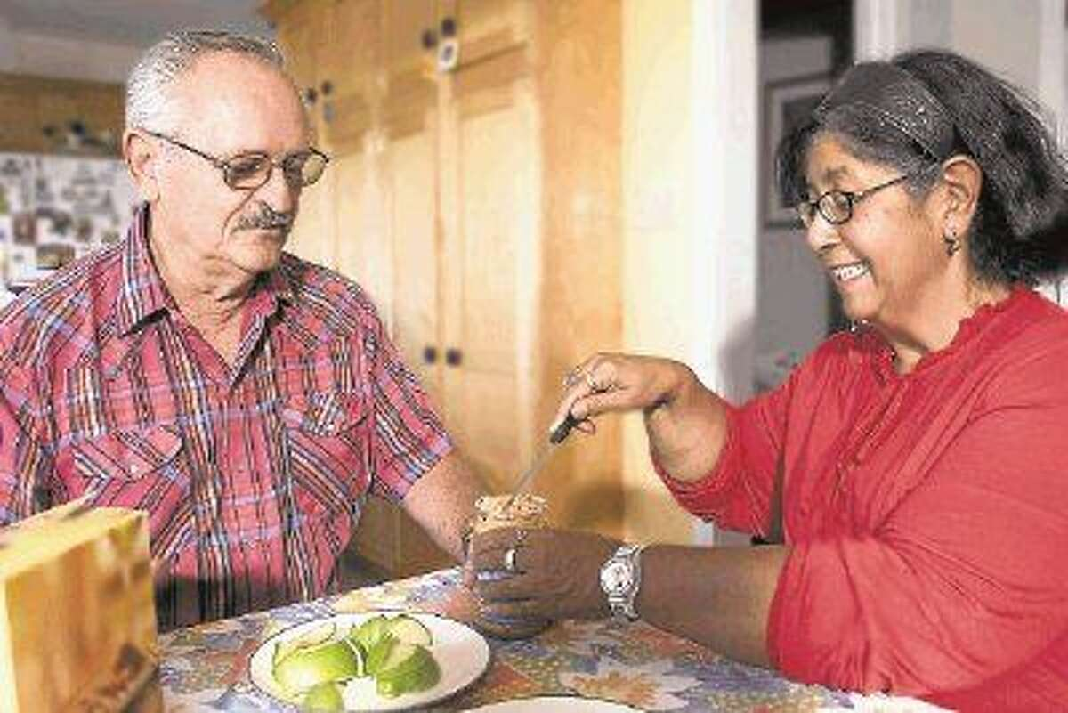 Pictured is a care provider (right) preparing a nutritious snack for a care recipient (left). This is one of many non-medical services offered by Seniors Helping Seniors Fort Bend.