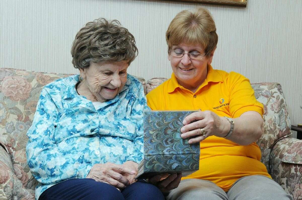Pictured is an employee of Seniors Helping Seniors (right) passing quality time with a care recipient (left). Seniors Helping Seniors Fort Bend offers in-home, non-medical companion services for the elderly.