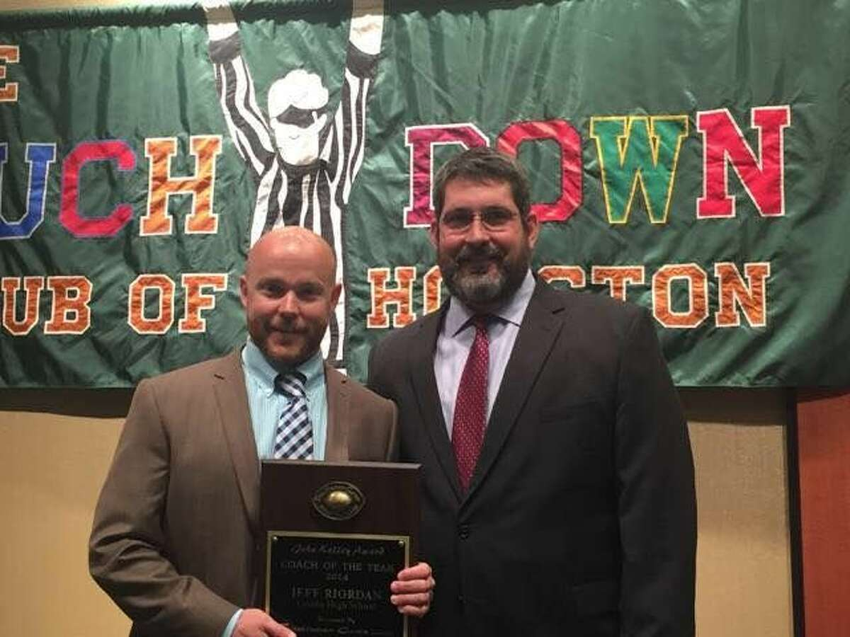 Crosby head coach Jeff Riordan accepts the 2014 Touchdown Club of Houston Coach of the Year Award on Wednesday night. Photo courtesy of Crosby ISD.