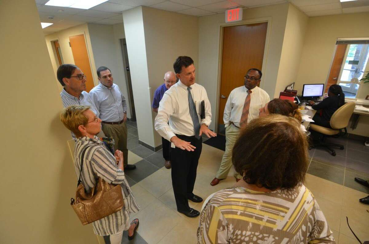 Hoffman explains the nuances of Bellaire's municipal buildings to gathered city council members. The tour was intended to show council members other municipal complexes and how they are set up.