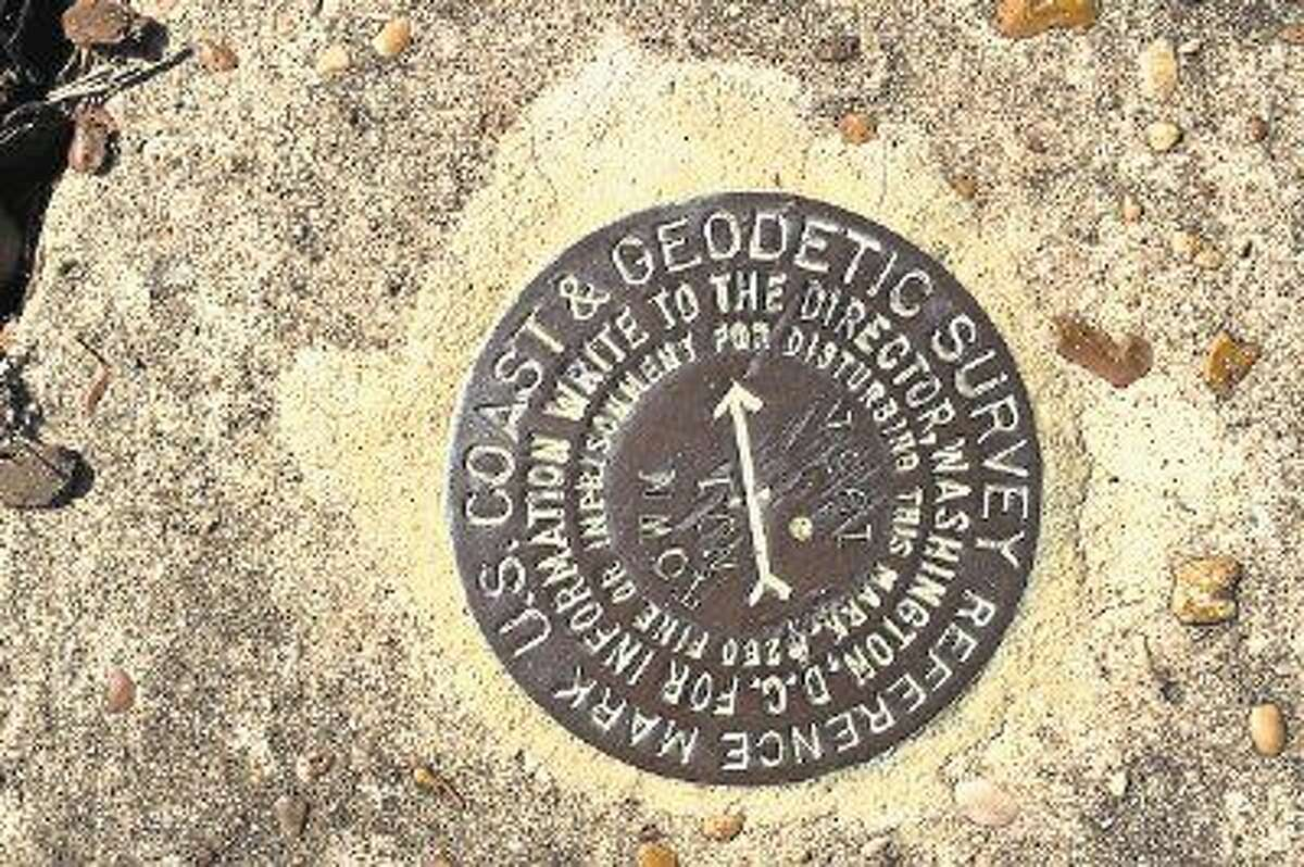 Know where to find more of these? This one is the survey reference marker on Trinity Street in Liberty, Texas. Other such reference markers, or bench markers, can be found all over the country.