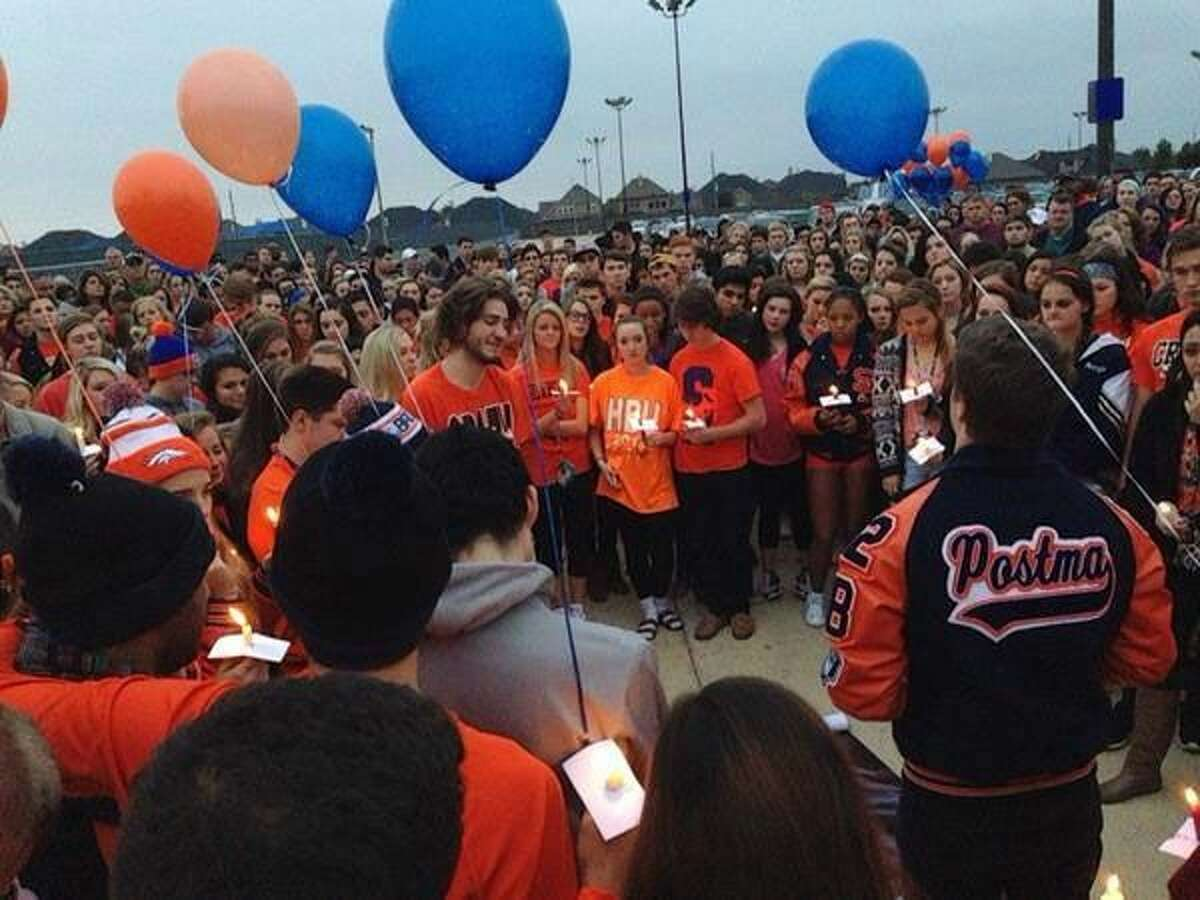 People remembered the students who died during a vigil at Seven Lakes High School Sunday night.