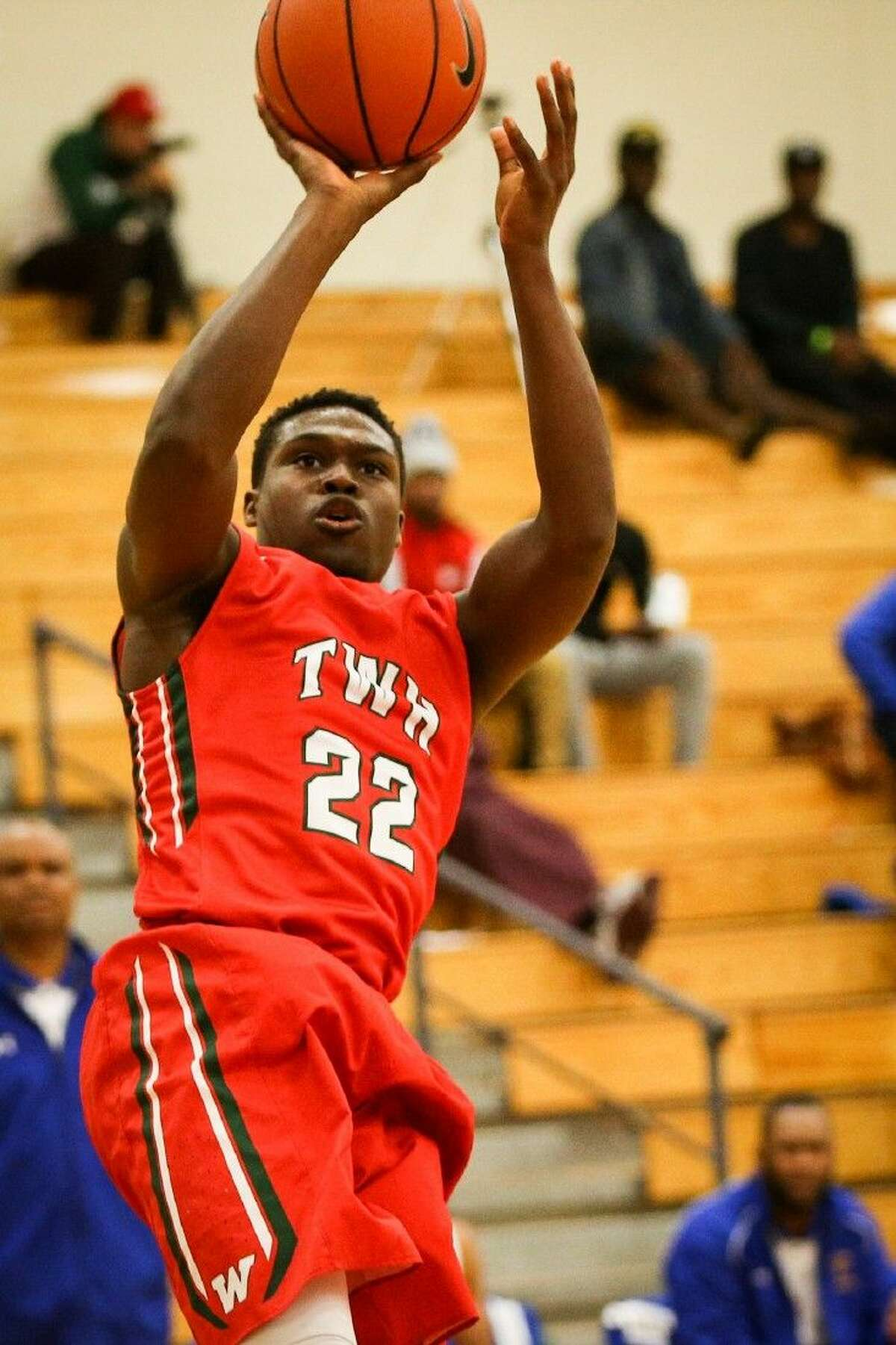 The Woodlands' Romello Wilbert (22) shoots the ball during a high school boys basketball game against Fort Bend Elkins this past Saturday night.