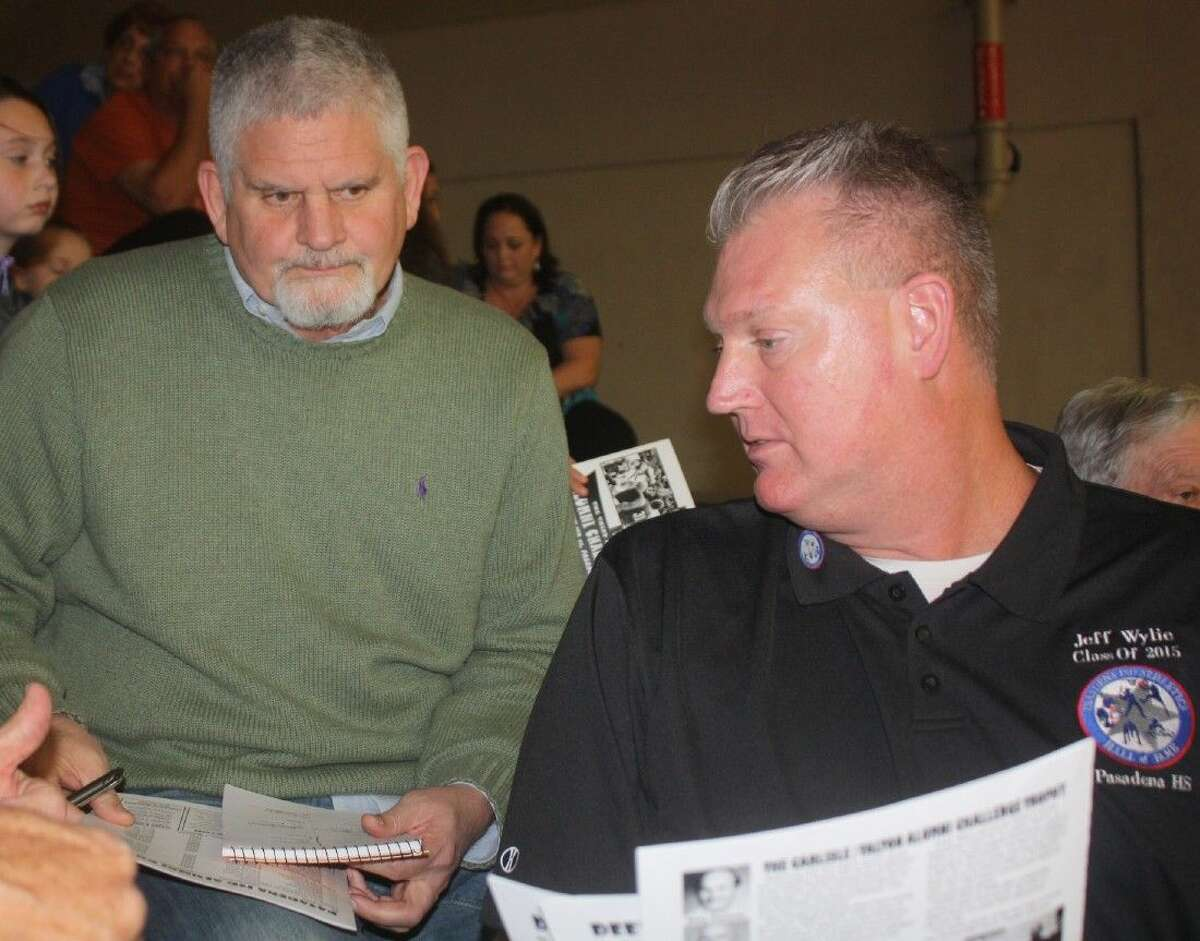 Phil Eaton (left) confers with Pasadena High basketball product and Hall of Fame inductee Jeff Wylie before last weekend's third annual Carlisle/Talton Alumni Challenge Game. Eaton returned to coach Pasadena ISD players for the first time since 1993, relishing that role one more time.