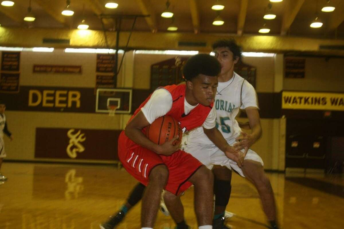 Memorial's defense puts the squeeze on a South Houston ballhandler during second-round action Friday at the Deer Park Thanksgiving JV Tournament. The Mavs enjoyed a 3-1 record, but lost to eventual champion Pearland Saturday morning 48-33.