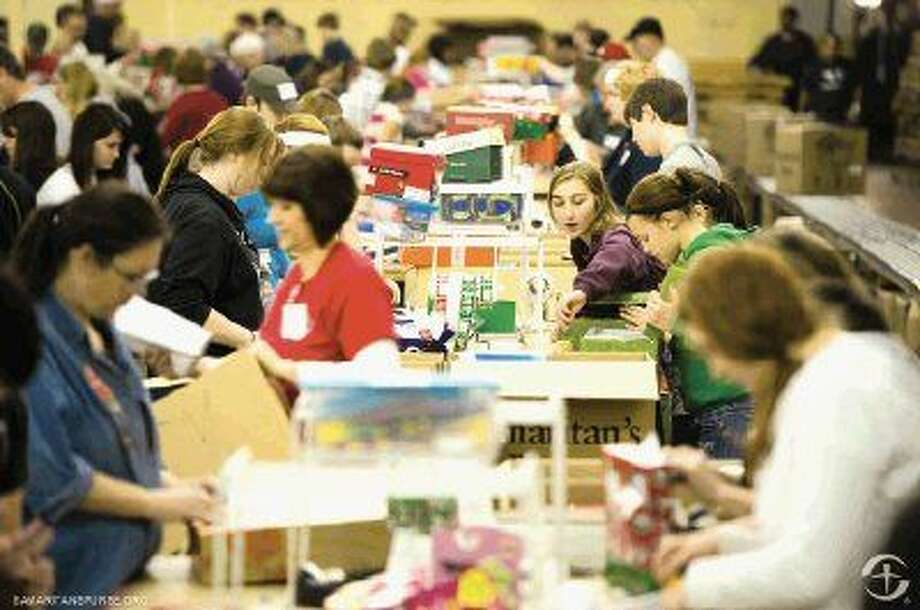 Humble area residents rallied together to pack 56,000 shoebox gifts last month for children worldwide struggling with war, disease, poverty and other difficult circumstances. Although the collection sites are closed for 2014, Humble residents can still contribute to the local collection number by packing a shoebox gift online at samaritanspurse.org. Photo: PAUL SHERAR
