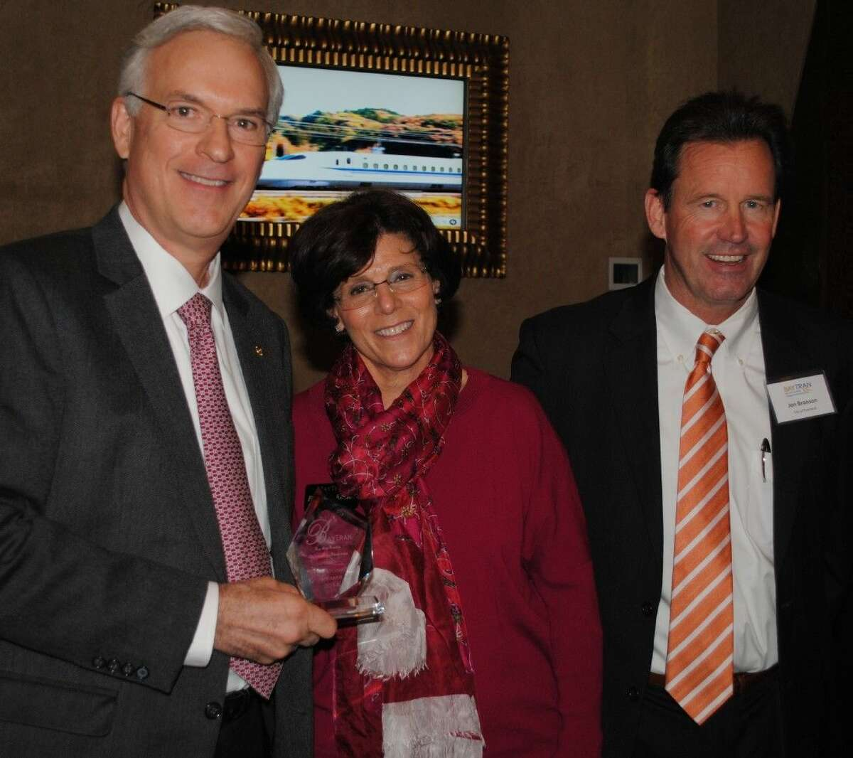 Bay Area Houston Transportation Partnership President Barbara Koslov and Chairman Jon Branson, right, greet former Harris County Judge Robert Eckels as he arrives at Cullen's Upscale Grille to address BayTran's monthly luncheon on the proposed high-speed rail line between Houston and Dallas.