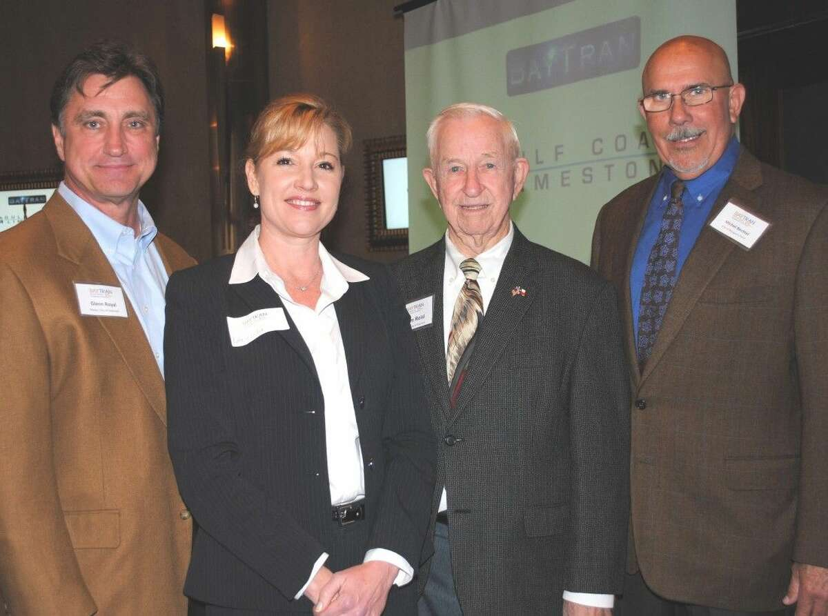BayTran's Natalie Picha welcomes, from left, Mayors Glenn Royal of Seabrook, Tom Reid of Pearland and Michel Bechtel of Morgan's Point as they arrive at the Bay Area Houston Transportation Partnership luncheon at Cullen's Upscale Grille to hear former Harris County Judge Robert Eckels discuss the proposed high-speed rail system between Houston and Dallas.