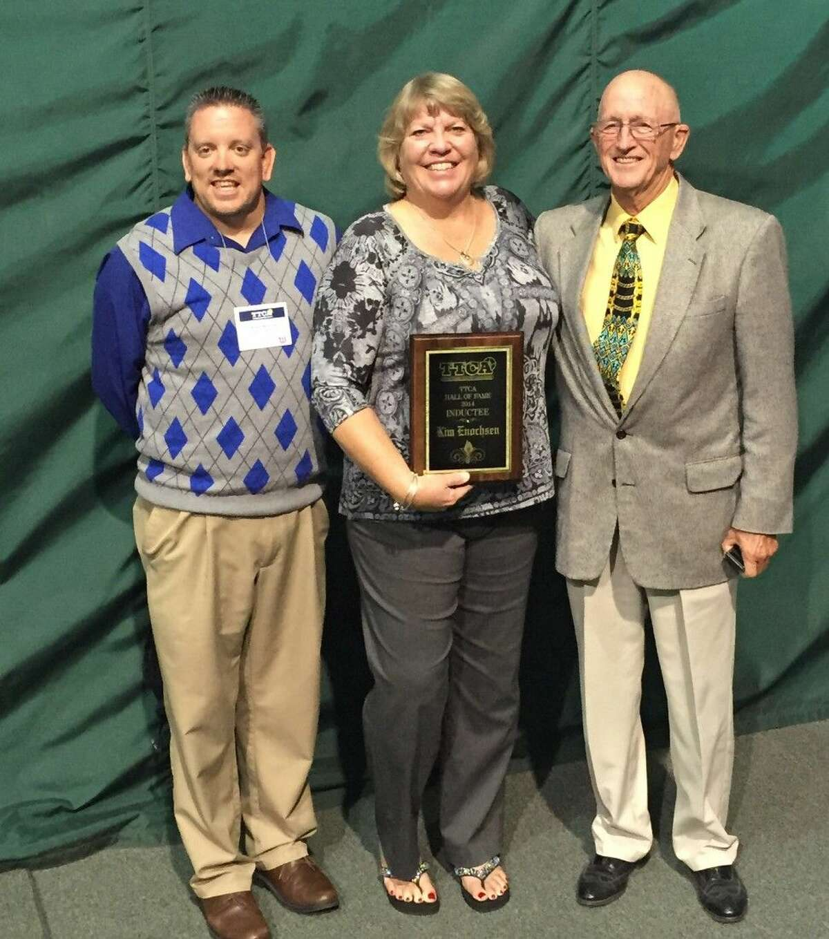 Texas Tennis Coaches Association Hall of Fame Induction. Pictured left to right, Kingwood High School Tennis Coach Kevin McElroy, Coach Kim Enocksen and Coach Jerry Franklin.