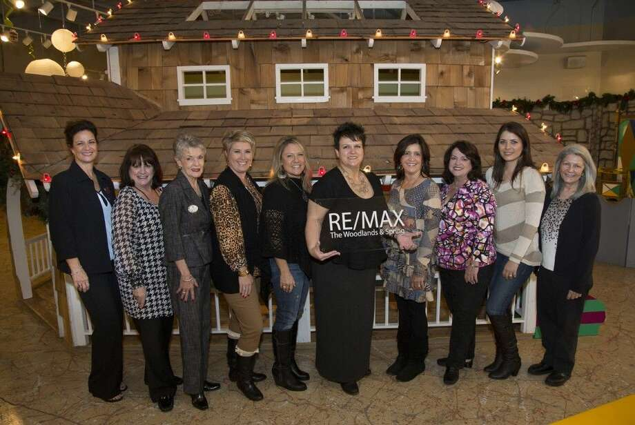 From left, Mary Phillips, The Woodlands Children's Museum community relations coordinator; RE/MAX The Woodlands & Spring Realtors Cheryl Littlejohn; Judy McEvoy; Stacie Fontenot; assistant Melanie Miles; Danna Furnace-Grimes, director of agent services and relocation director; Realtors Christine Hale, Carol Knott and Kassandra Bissett; and Angela Colton, executive director of the museum.