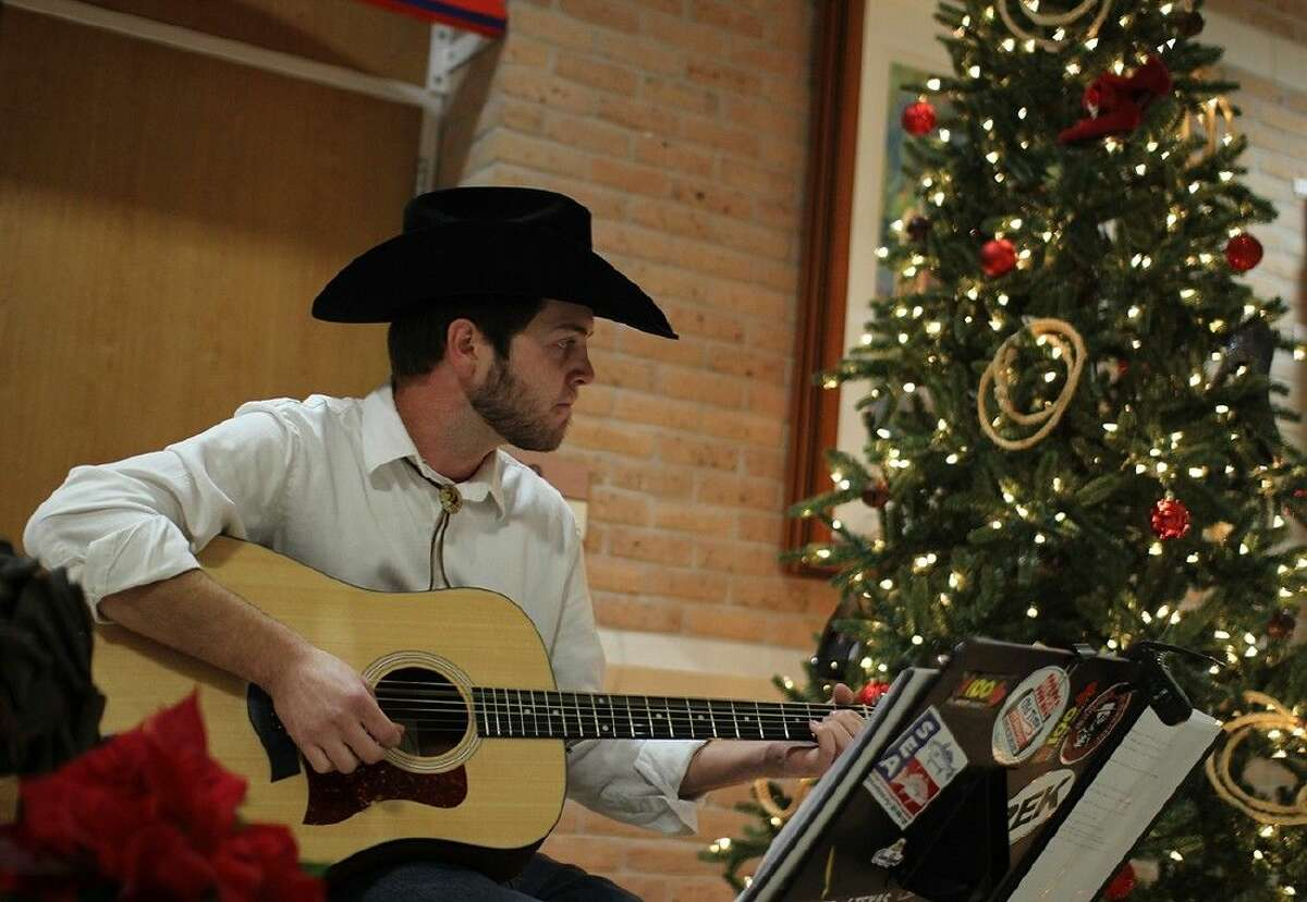 ACC student Zach Davis, of Manvel, performs during the Foundation Christmas Gala on December 2.