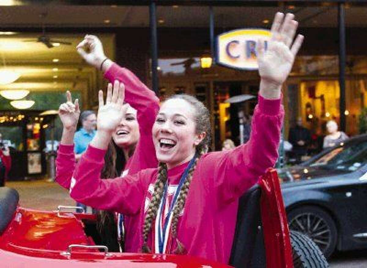 The Woodlands volleyball player Julia Pasch waves to fans during a parade in celebration of the program's second straight state volleyball title at Market Street Thursday, Dec. 11. To view or purchase this photo and others like it, visit HCNpics.com.