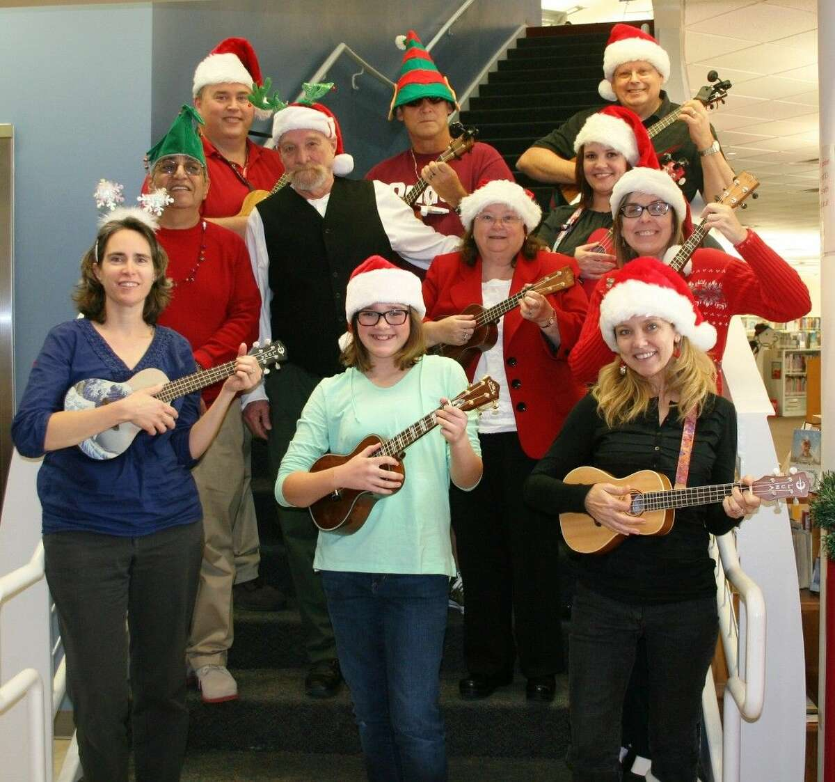 The ukulele group, which hosts classes at R.B. Tullis Branch Library in New Caney, performed for those present at the holiday open house, hosted by the library staff members on Dec. 9.