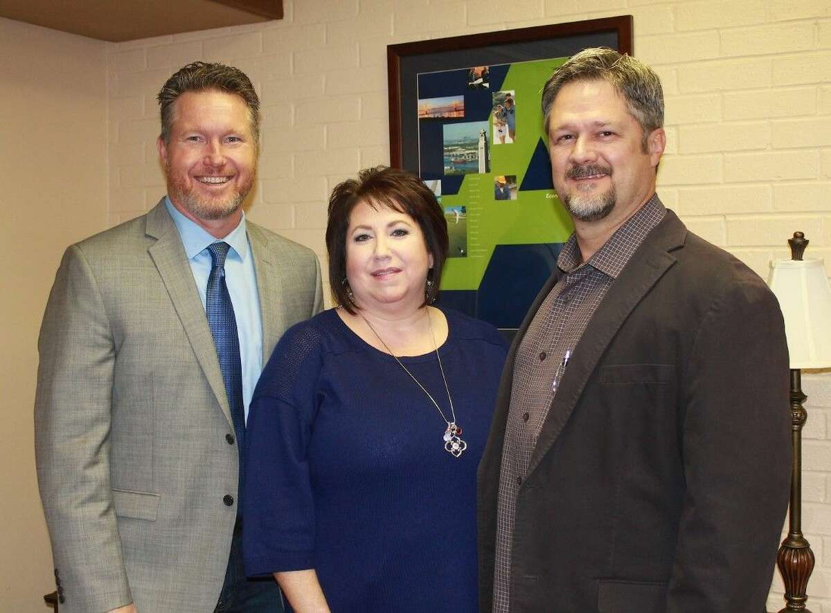 President ands CEO Chad Burke poses with Tammie Mouton and Deer Park Mayor Jerry Mouton.
