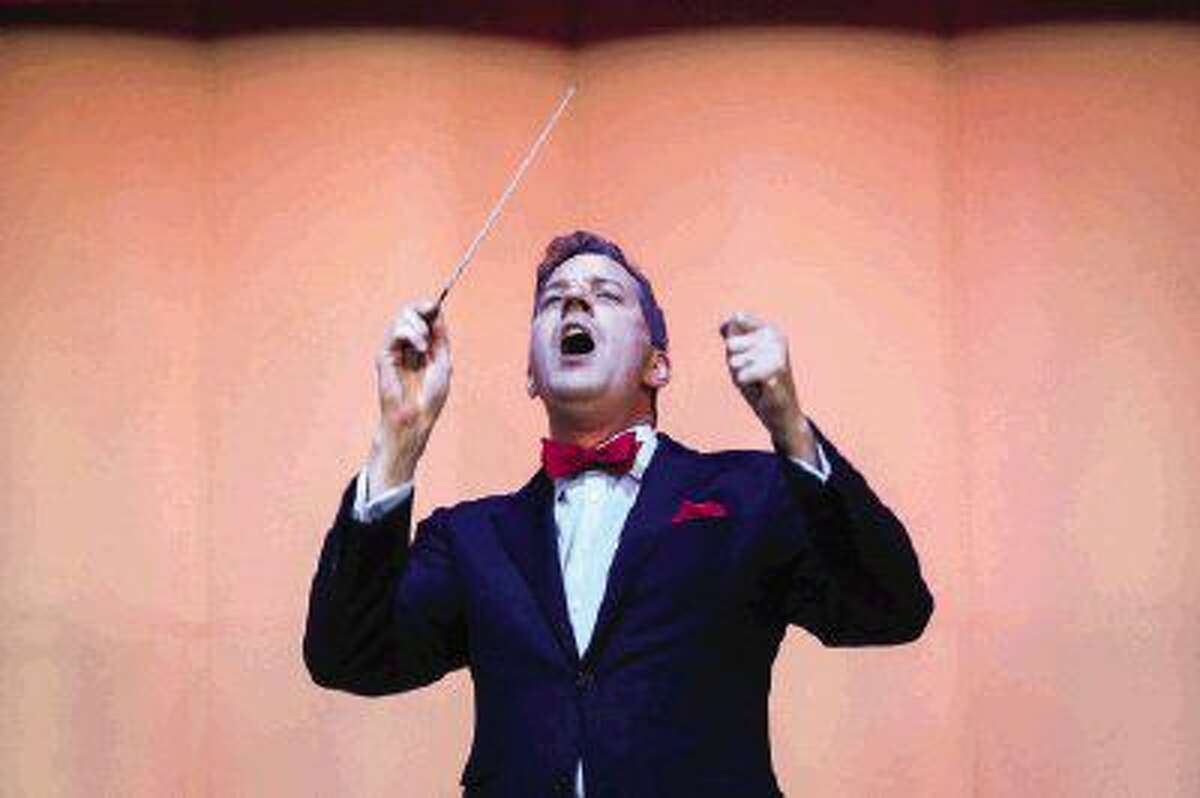 Conductor Steven Reineke leads the Houston Symphony during the Star Spangled-Salute concert on Sunday at the Cynthia Woods Mitchell Pavilion.