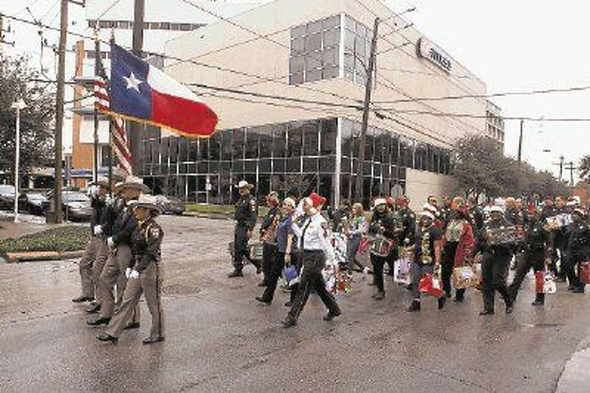 Members of the Sheriff's Office lead the caravan during the 20th Annual Toy Delivery to Children's Assessment Center in Houston, Texas.