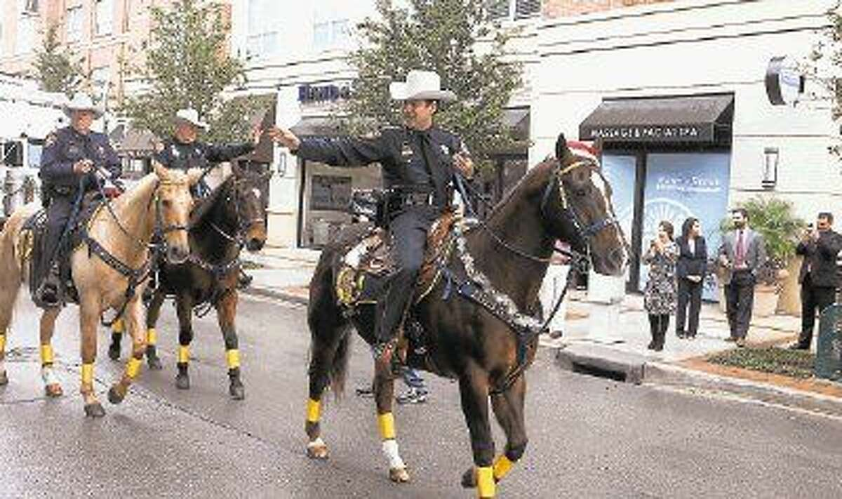 Sheriff Adrian Garcia, the HCSO Mounted Patrol, and other members of the Sheriff's Office lead the caravan.