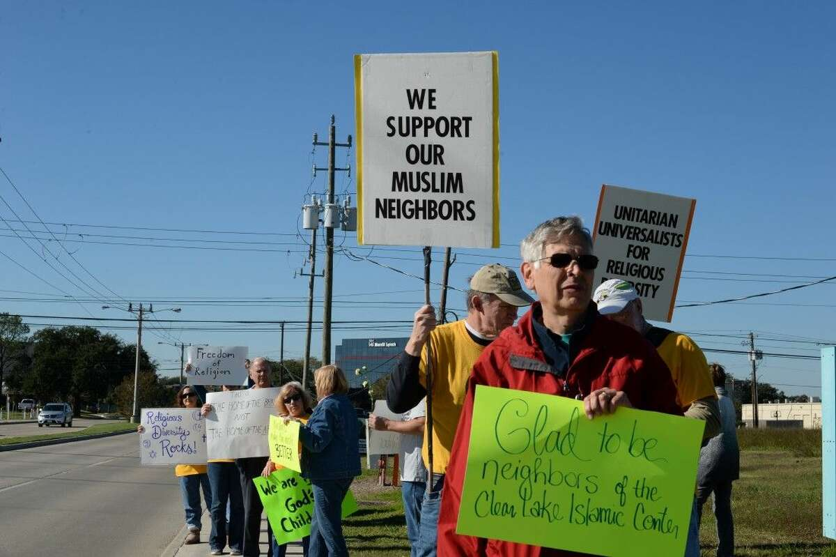 Near the entrance to a road leading to both the Bay Area Unitarian Universalist Church and the Clear Lake Islamic Center on El Camino, about 200 people held a rally Friday afternoon promoting religious tolerance.