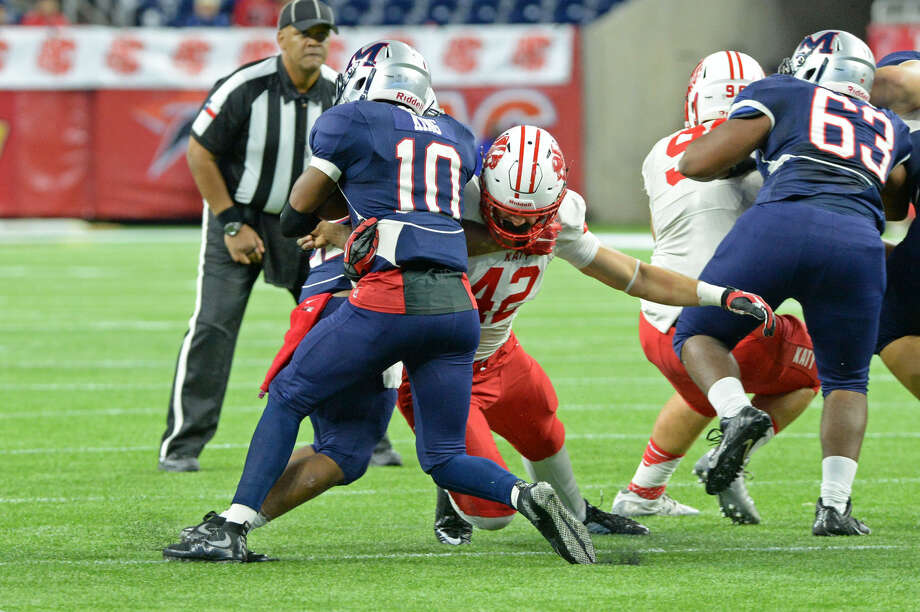 Katy's Paddy Fisher wraps up Manvel quarterback D'Eriq King during their Class 6A Division II regional final Dec. 4 at NRG Stadium in Houston. Katy won 35-17 for its fourth consecutive regional title. To view or purchase this photo and others like it, visit HCNpics.com. Photo: Craig Moseley