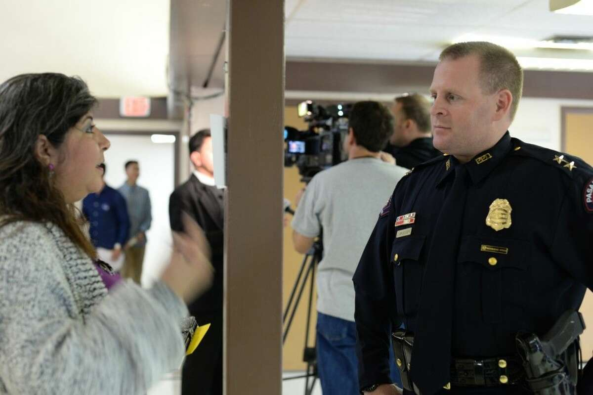 PPD Assistant Chief Josh Bruegger listens to a resident at a public forum meeting on Sunday at St. Peter's.