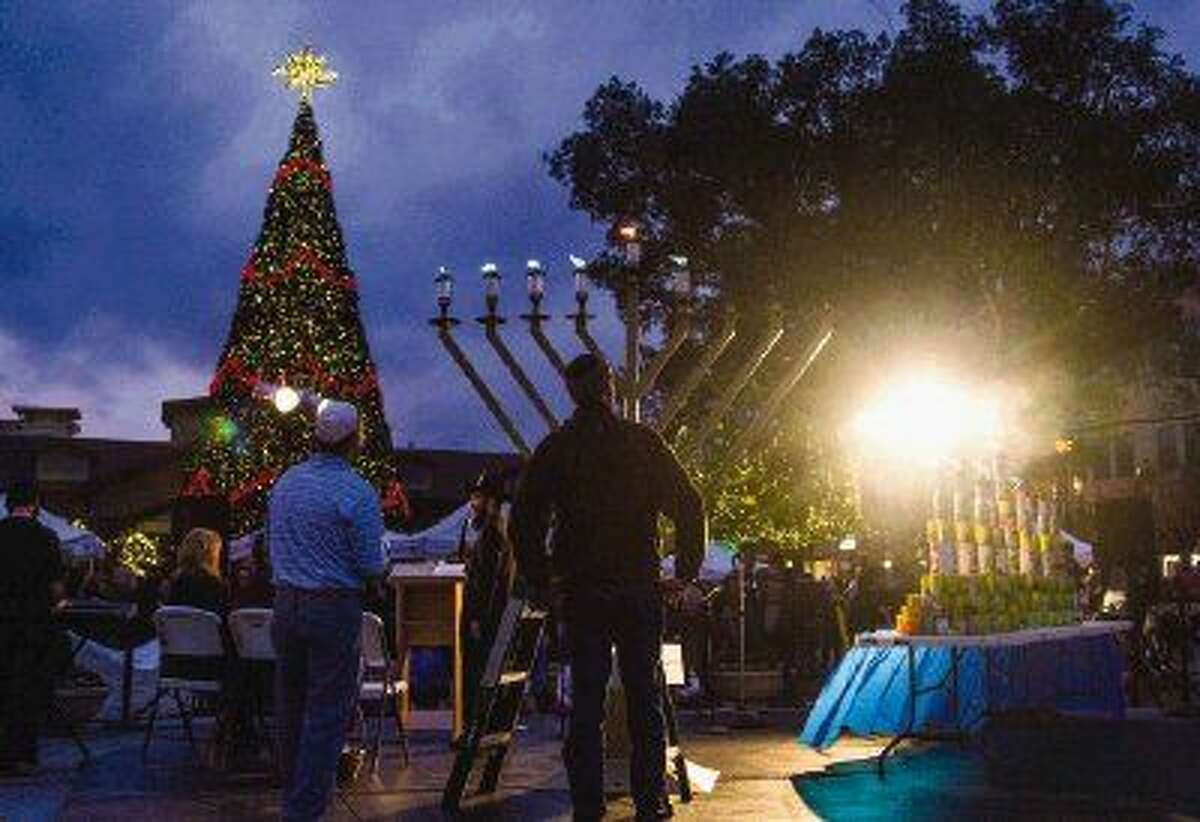 People gather for the third Grand Chanukah Celebration and Menorah Lighting at Market Street on Sunday in The Woodlands. Chabad of The Woodlands is hosting the event again this year on Thursday, Dec. 18, to celebrate Chanukah.