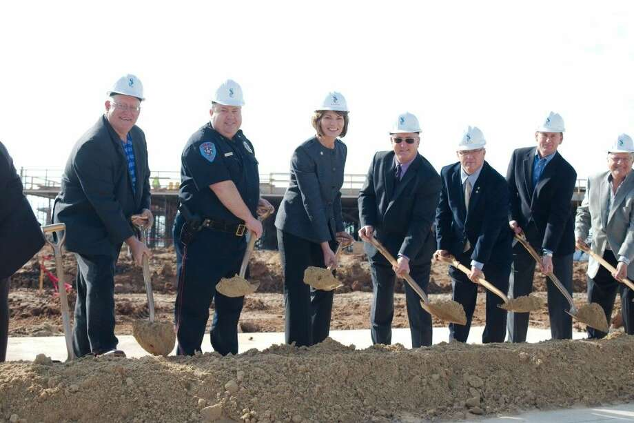 Shoreacres Police Chief Troy Harrison, left center, stands with San Jacinto College Chancellor Dr. Brenda Hellyer, center, and Shoreacres Mayor Rick Moses as they join members of the San Jacinto Colege Board to ceremoniously break ground on the San Jacinto College Maritime Training Center in Shoreacres Friday, Dec. 12.