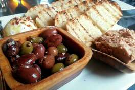 Photo by Matthew Woods A beautiful platter of warm olives and an olive tapenade, along with a generous helping of sopraffina ricotta cheese and some grilled bread at Villa D'Alessandro located at 801 E. Wackerly St. in Midland.