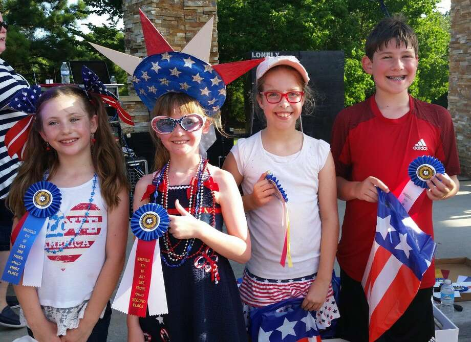 Winners in the Magnolia Fourth in Unity Park, Only in America, Bicycle/Tricycle and Scooter Parade grades 3 thru 5 Division were, from left: First place, Kailey Caldwell; second place, Natalie Smith; third place, Emma Vickers; and fourth place Samuel Griffin. Photo: Submitted