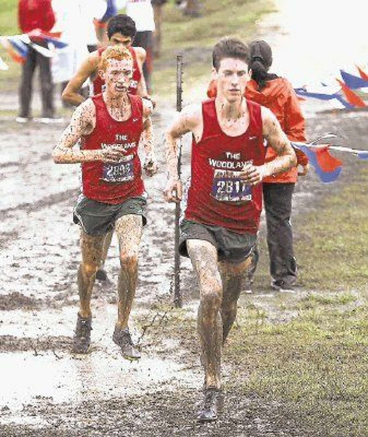 The Woodlands' Matthew McClellan and Nicholas Enochs compete in the Class 6A UIL State Cross Country Championships back in November. The Woodlands Highlanders finished sixth in the nation at the Nike Cross Nationals meet in Portland, Ore. on Saturday.