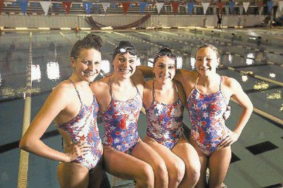 From left to right: Magnolia Aquatic Club swimmers Kaitlynn Sims (Montgomery), Lucie Nordmann (The Woodlands), Emily Reese (The Woodlands) and Joy Field (Magnolia) participated in the U.S. Olympic Team Trials last week in Omaha. Photo: Michael Minasi