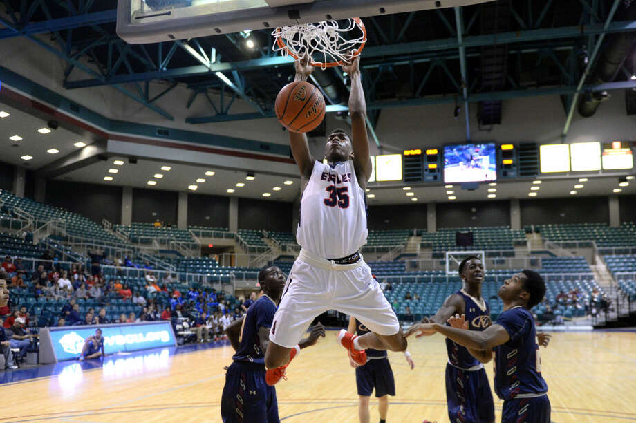 Atascocita's Fabian White throws down a dunk against Klein Collins during the Phillips 66 Katy Classic championship game Dec. 5 at the Leonard Merrell Center in Katy. Atascocita won 93-66. To view or purchase this photo and others like it, visit HCNpics.com. Photo: Craig Moseley